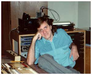 a guy siting in a recording studio